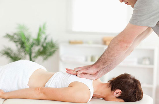 patient getting chiropractic care on upper back