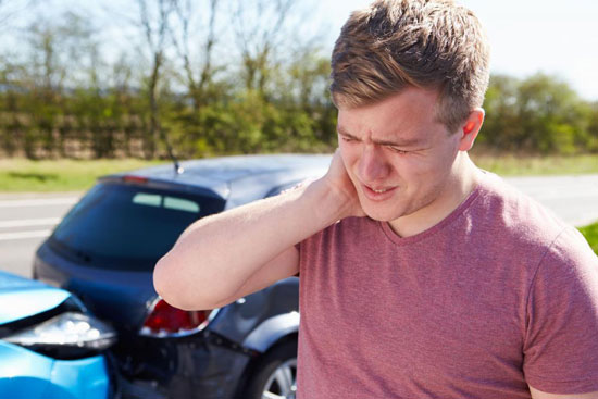 man experiencing whiplash after car accident